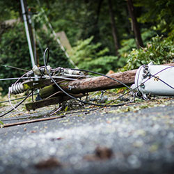 A hydro pole and wires down on the street after a severe storm.
