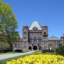 A picture of Ontario's legislative building in spring.