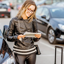 A woman reviewing her car rental agreement.