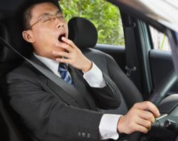 Driver yawns while behind the wheel